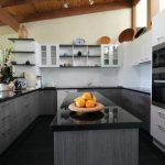 A Modern Kitchen with a centre island bench and masses of storage options.