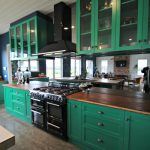 Green Kitchen shaker doors and Bamboo benches