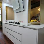 A design solution for a modern kitchen in an old monastry with heritage considerations.