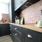 undermount rangehood,black joinery, cabinetry, storage ideas