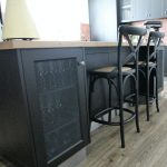 island bench, timber bench, timber floor, black cabinetry